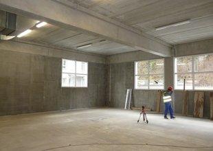 Nová betonová podlaha v 1.NP přístavby