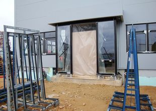 Entrance to the administrative section - installation of glass walls with automatic doors