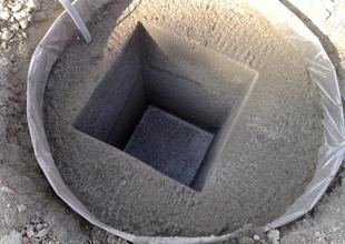 Concreted pilot cap with pocket for column placement