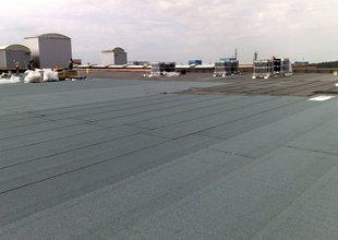 Placement of final layer of modified asphalt membranes