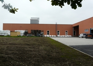 East view - existing manufacturing hall and the new warehouse