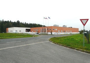 Overall view of existing manufacturing hall and new warehouse