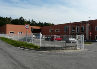 Facility entrance - view of the existing manufacturing hall and the new warehouse