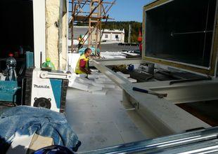 Tepelné zaizolování stropu přístavby navazující na střechu stávající haly